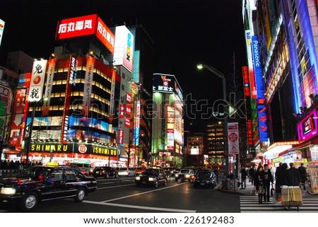 AKIHABARA, JAPAN - APRIL 3 : Night life in AKIHABARA district taken April 3, 2007 in Tokyo. Landmark of Akihabara, popular in electric equipment , video game, computer and anime shop. - stock photo