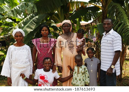 AKURE, NIGERIA - AUGUST 12, 2012: The unidentified members of a nigerian family from Akure, show their traditional clothes for a portrait, in a local village at Ondo state in Nigeria, on August 12, 2012 - stock photo