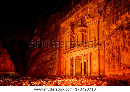Al Khazneh in the ancient Jordanian city of Petra, Jordan at night. It is known as The Treasury. Petra has led to its designation as a UNESCO World Heritage Site.. - stock photo