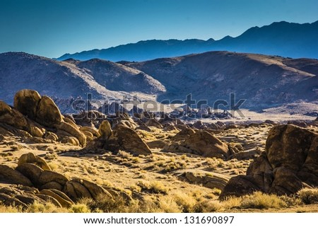 Alabama Hills are a hills and rock formations near the eastern slope of the Sierra Nevada Mountains west of Lone Pine, California - stock photo