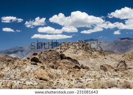 """Alabama Hills are a """"range of hills"""" and rock formations near the eastern slope of the Sierra Nevada Mountains in the Owens Valley, west of Lone Pine in Inyo County, California. - stock photo"""