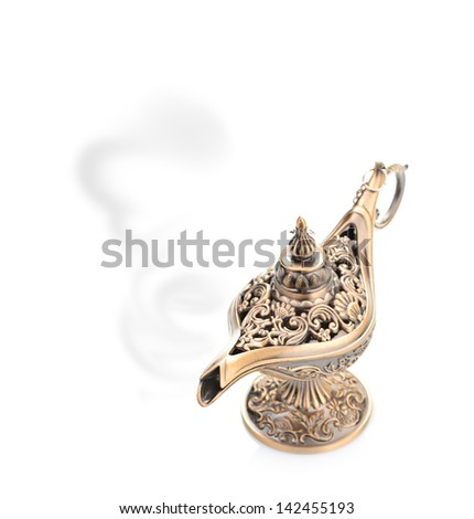 Aladdin magic lamp isolated on white - stock photo