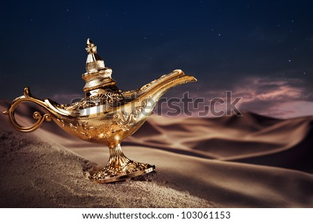 Aladdin magic lamp on a desert - stock photo