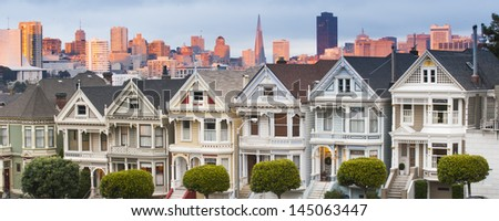 Alamo Square, San Francisco, California. Sunset at San Francisco Financial District in the background - stock photo