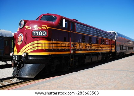 ALAMOSA, CO, USA - JUNE 6, 2013: A diesel-powered locomotive waits for departure at Alamosa station. This scenic train rides to Monte Vista from June to August.  - stock photo
