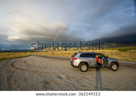 ALAMOSA, COLORADO, USA - AUGUST 26: View of an offroad vehicle near the Great Sand Dunes National Park at sunset on August 26, 2015. Its popular for tourist to drive suv vehicles in nature parks. - stock photo