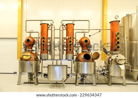 ALAND ISLANDS, FINLAND - AUGUST 18, 2014:Smakbyn distillery turns local fruit into Alvados, apple brandy, and Rod Granit, cherry liquer. In cool cellar beverages are stored in oak barrels - stock photo