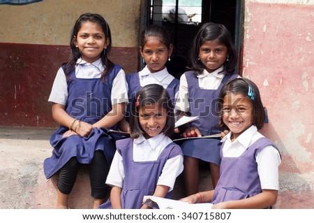ALANGAON, MAHARASHTRA, INDIA - February 22, 2014: Happy Indian rural girl at their school, Alangaon, Amravati , Maharashtra, India - stock photo