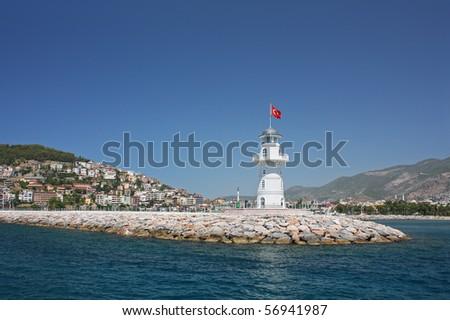Alanya beacon on a deep blue sky background - stock photo