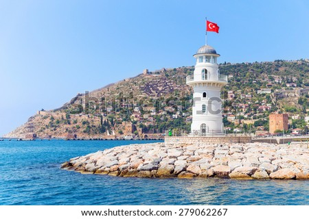 Alanya lighthouse with fortress and Red tower on the background - stock photo
