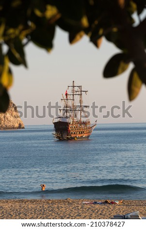 Alanya - the pirate ship at the beach of Cleopatra - stock photo