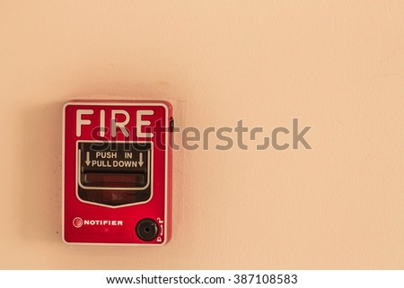 Alarm button to alert the fire. - stock photo
