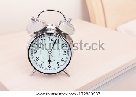 alarm clock and bed in the morning - stock photo