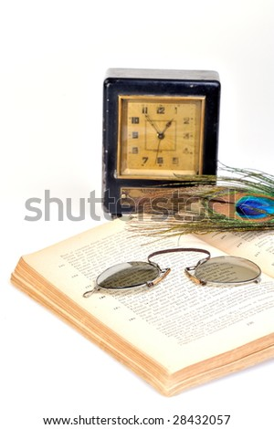 alarm clock and book against white background - stock photo