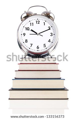 Alarm clock and books isolated on white - stock photo