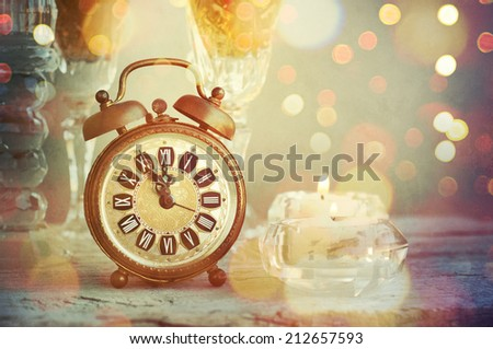 Alarm clock and candle - stock photo