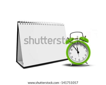 Alarm clock and desktop calender - stock photo