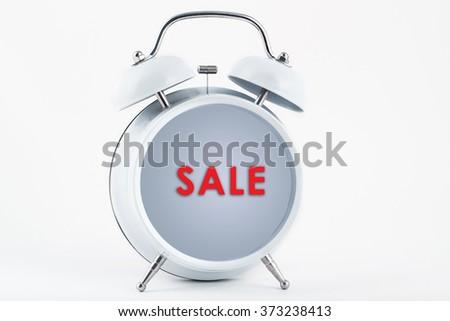 Alarm clock and sale - stock photo
