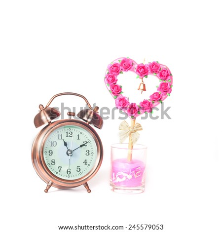 alarm clock and sign of love  - stock photo
