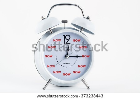 Alarm clock and very hour is now - stock photo