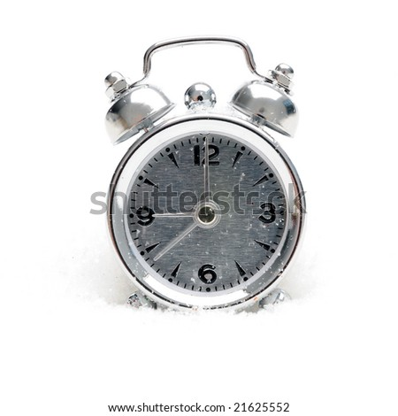 alarm clock in the snow - stock photo