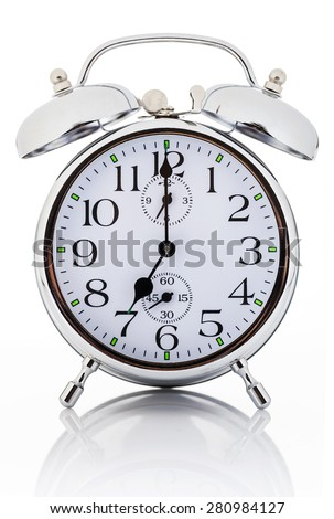 Alarm clock isolated over white background - stock photo