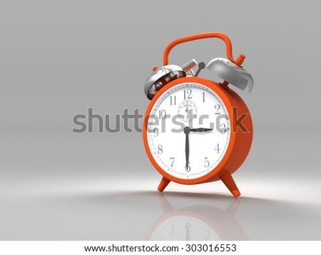 Alarm clock on a gray background. - stock photo