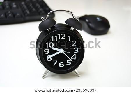 alarm clock on desk - stock photo
