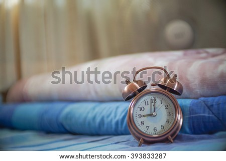alarm clock on my bed,selective focus. - stock photo
