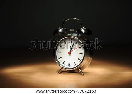 Alarm clock on the table in the night (light paint technique) - stock photo