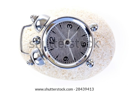 alarm clock on white stone - stock photo
