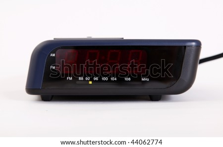 Alarm clock over white background. Time machine - stock photo