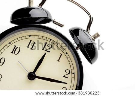 alarm clock showing different times - stock photo