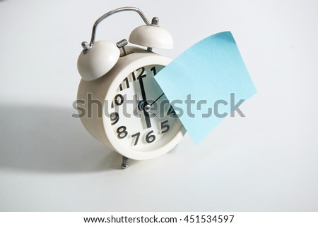 alarm clock with a sticky note - stock photo