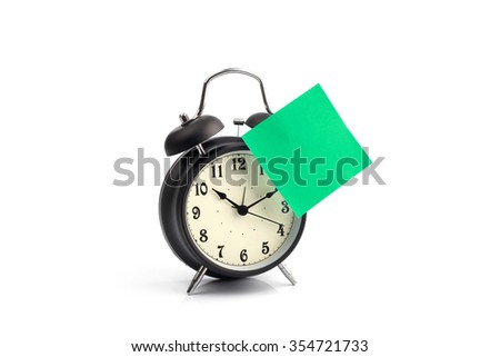 Alarm clock with blank or empty adhesive note - stock photo