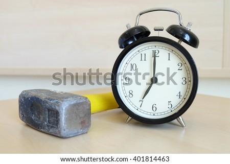 alarm clock with hammer - stock photo