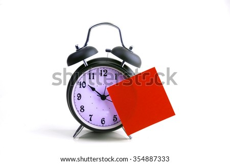 Alarm clock with red sticky paper - stock photo