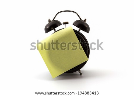Alarm clock with sticky paper on white background.   - stock photo