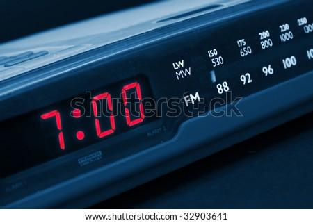 Alarm radio clock indicating time to wake up - stock photo