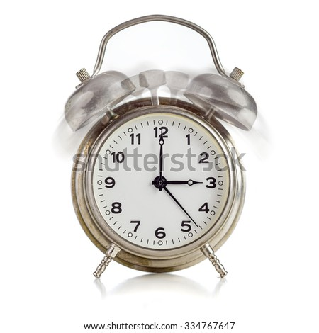 Alarming old dirty vintage metal clock showing three o'clock over white background - stock photo