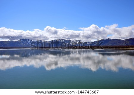 Alaska landscape blue sky reflections in water - stock photo