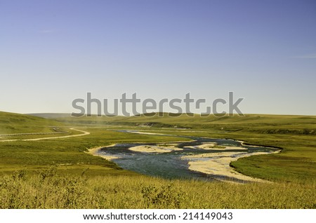 Alaska oil pipeline and stream - stock photo