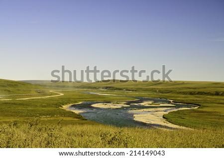 Alaska oil pipeline and stream - stock photo