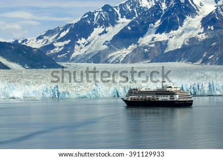Alaskan cruise ship destination vacation with ice glacier background - stock photo