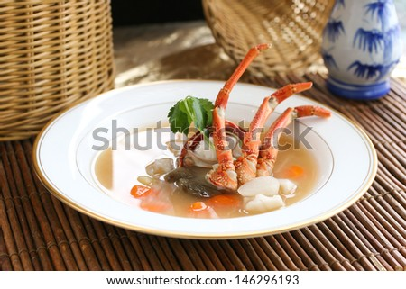 Alaskan king crab clear consomme soup in fine dining style - stock photo