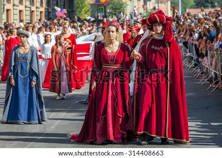 ALBA, ITALY - OCTOBER 02, 2011: Participants in historic dresses on Medieval Parade - traditional part of celebrations during annual White Truffle festival taking place each year in Alba, Italy. - stock photo