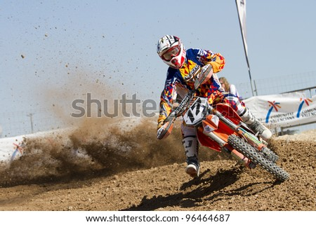 ALBAIDA, SPAIN - FEBRUARY 26: Jose Antonio Butron pilot of motorcycling in the Spanish championship of motocross on February 26, 2012, Albaida, Spain - stock photo