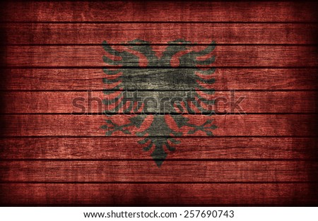 Albania flag pattern on wooden board texture ,retro vintage style - stock photo