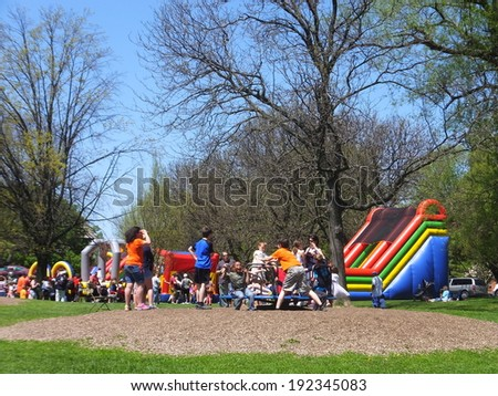 ALBANY, NY - MAY 11: Playground at the 2014 Tulip Festival at Washington Park in Albany, New York State, on May 11, 2014. The first Tulip Fest was celebrated on May 14, 1949 and is an annual event. - stock photo