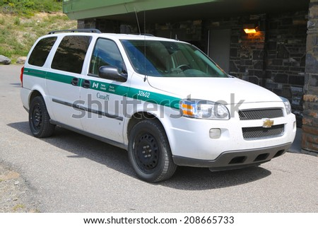 ALBERTA, CANADA - JULY 27: Parks Canada Park Wardens car in Banff National Park in Banff on July 27, 2014.Parks Canada was established on May 19, 1911 - stock photo